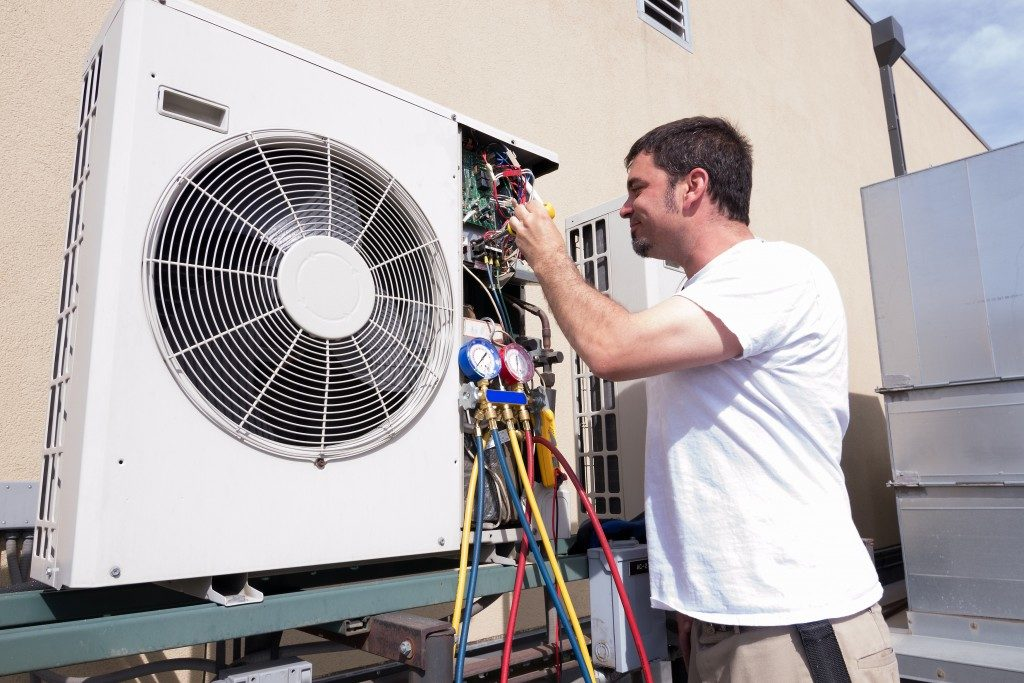 HVAC technician working on a condensing unit