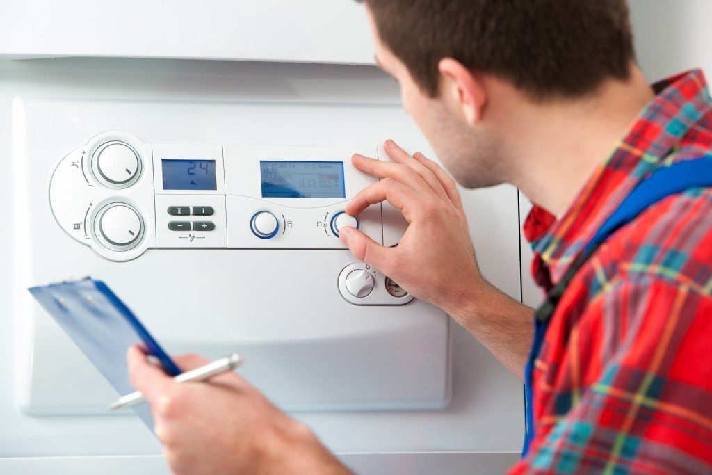 Man checking the heating system