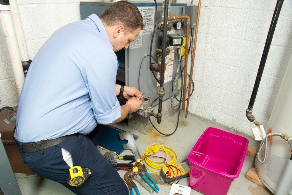 technician doing maintenance on furnace