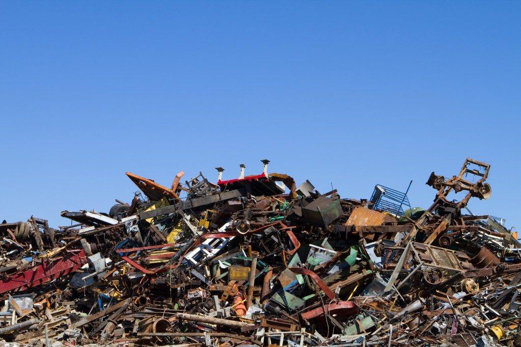 Scrap metal waste is stored in a recycling yard