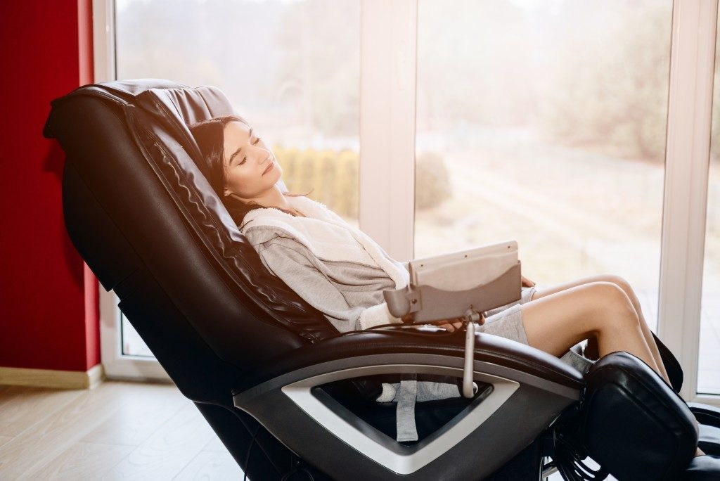 Woman relaxing on massage chair