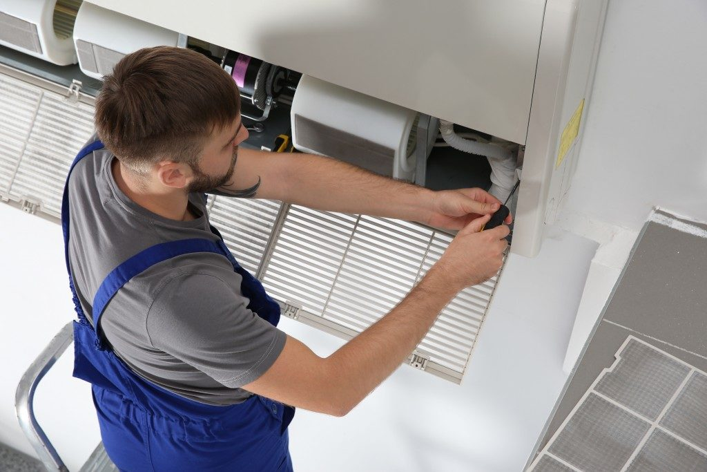 plumber fixing ventilation