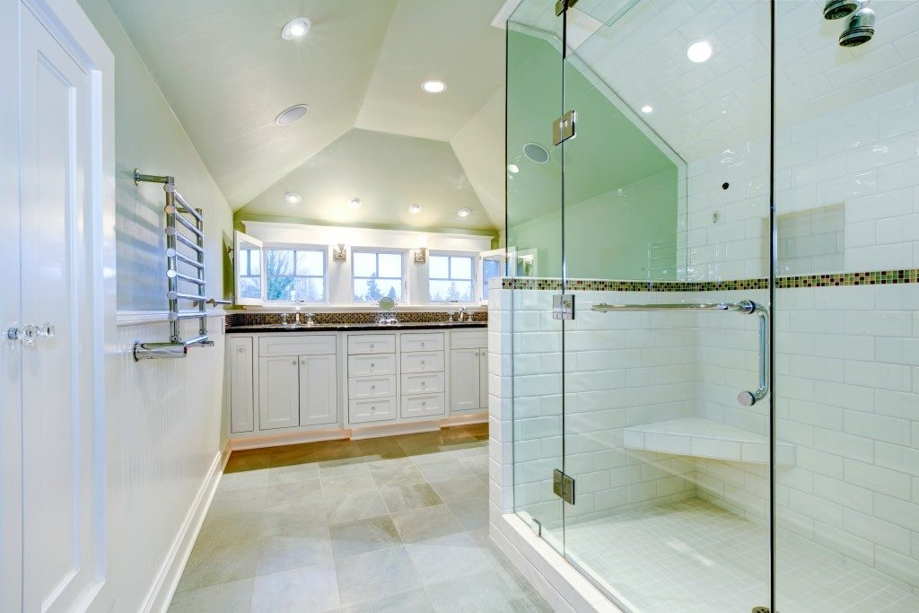 A newly renovated bathroom with porcelain floors