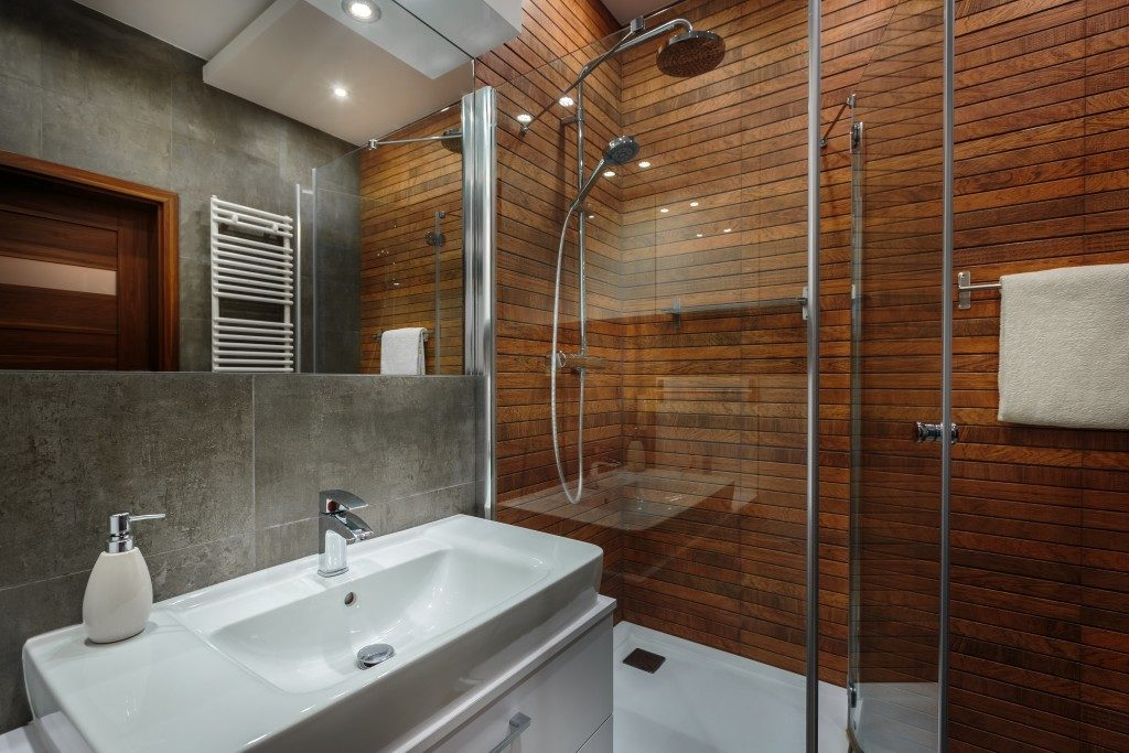 A modern bathroom with brown walls