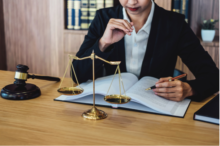 paralegal reading a document