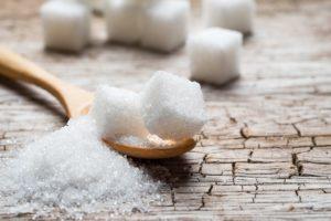 White sugar cubes on a spoon