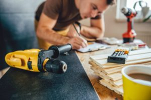man making plans for renovation