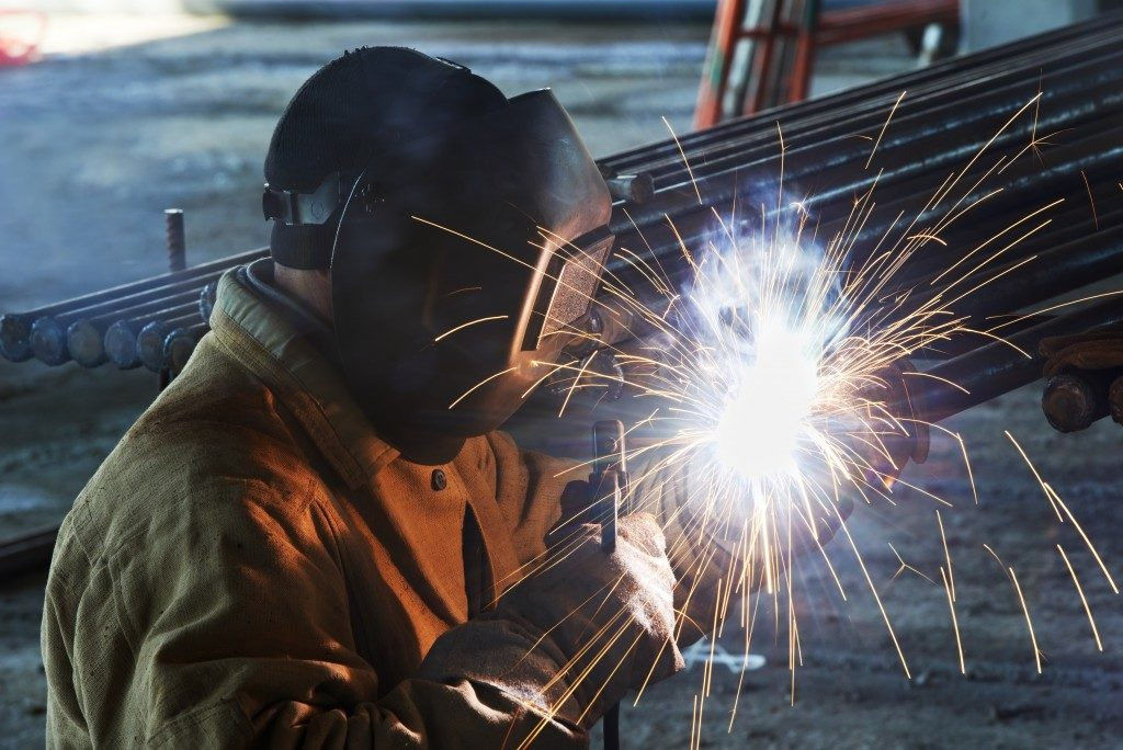 Man welding on metal