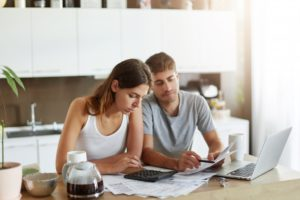 Couple calculating the expenses