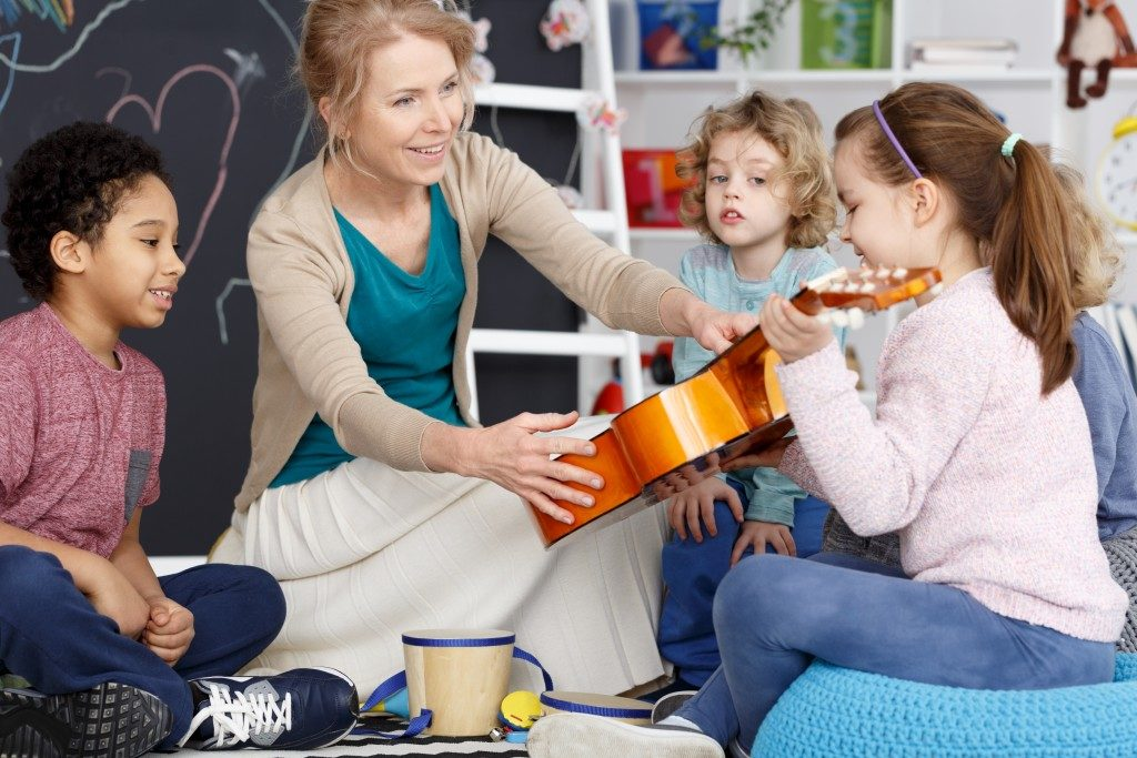 teacher in her music class