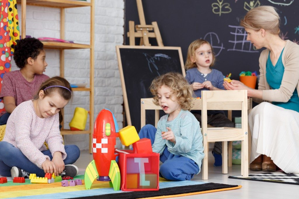preschool classroom with kids playing