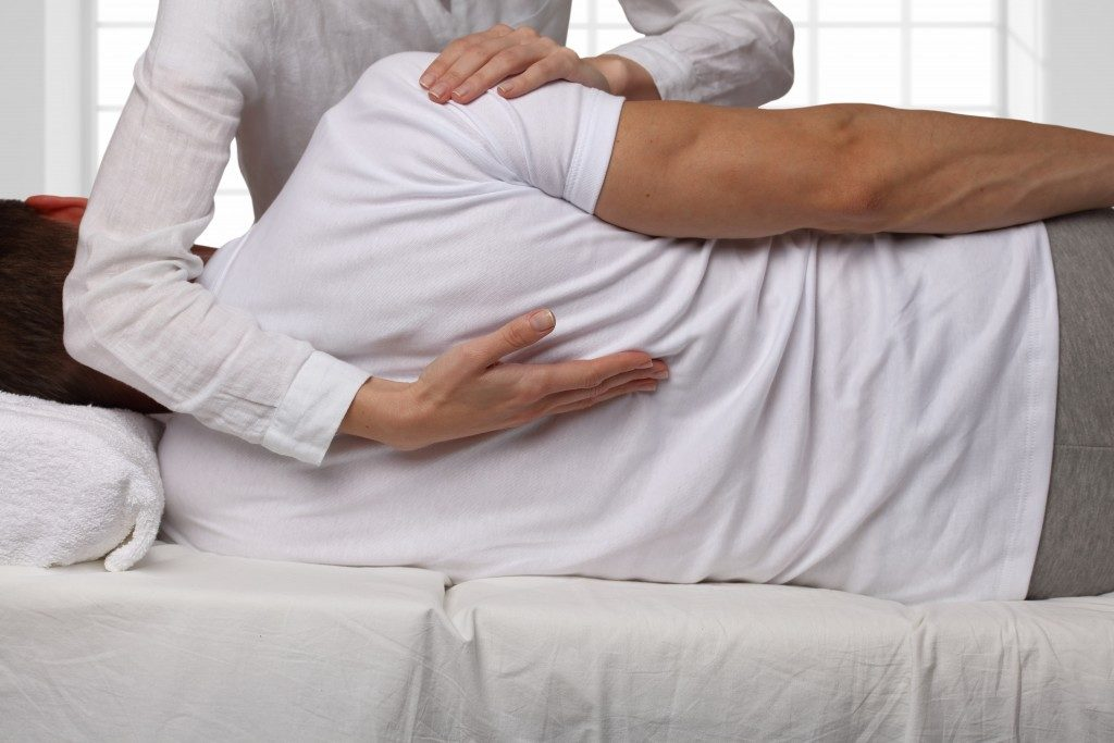 chiropractor giving man treatment