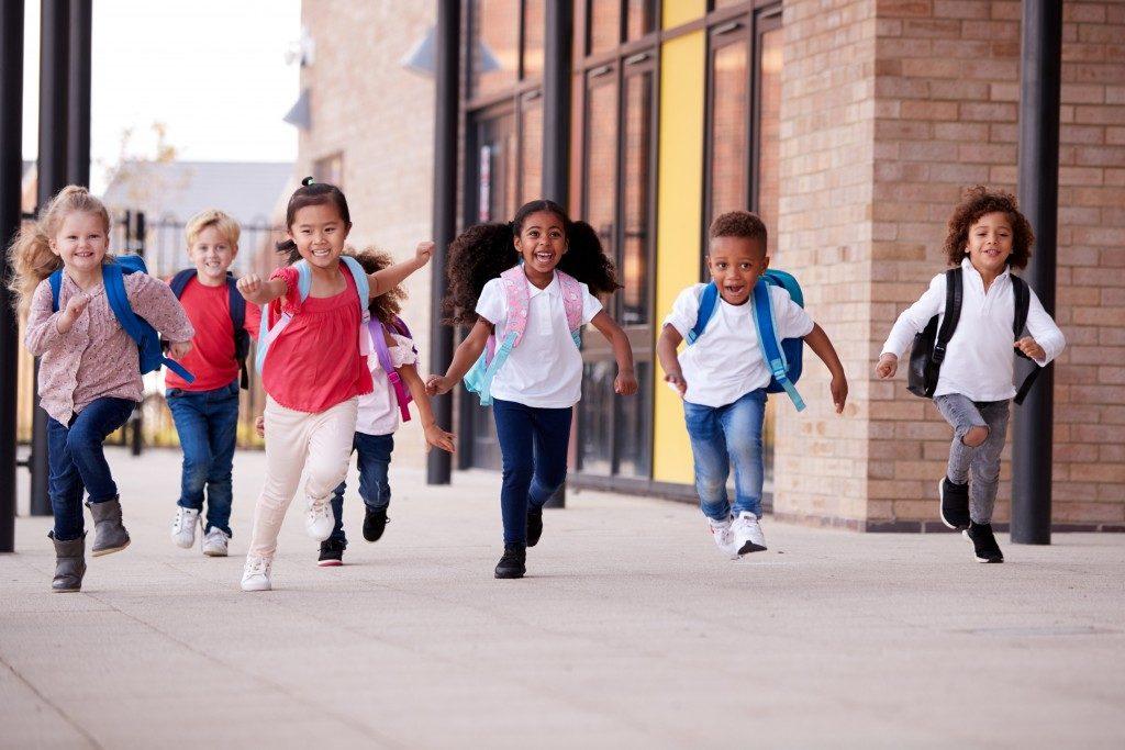 children running at the school corridor