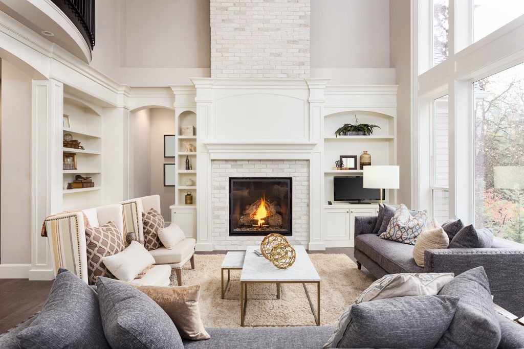 luxurious living room with comfortable seats by the fireplace