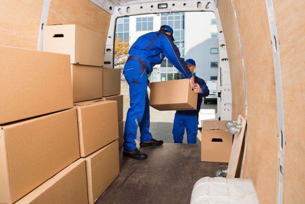 men putting boxes in the van