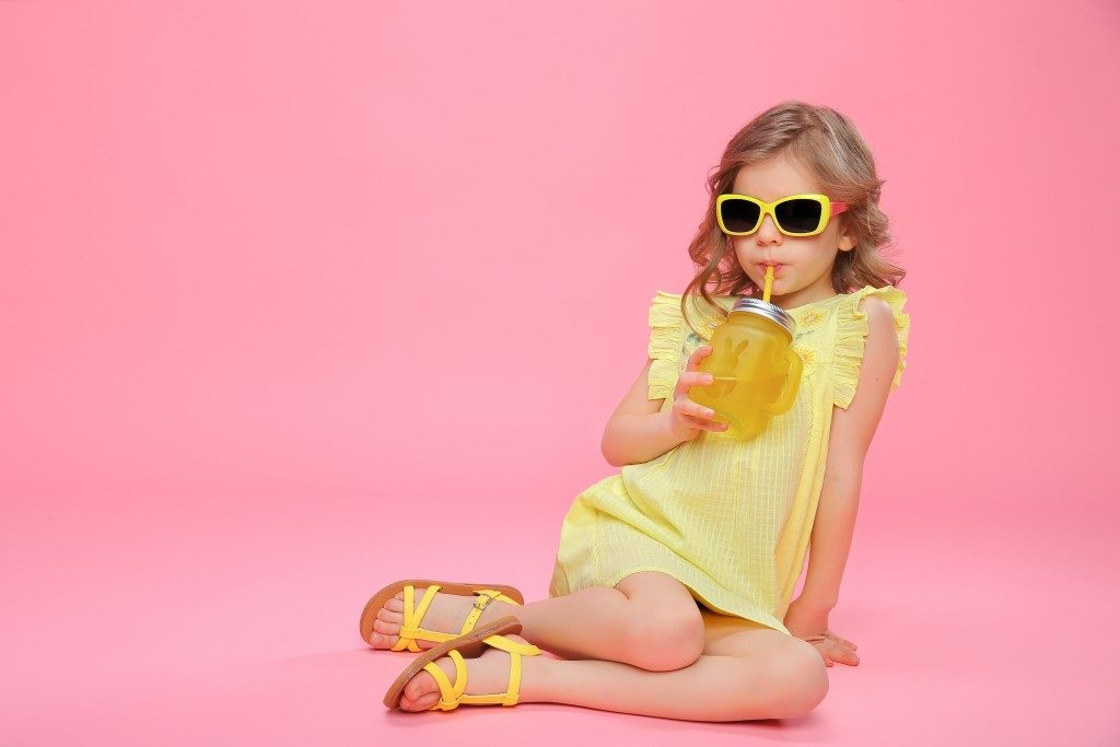 child model on pink background and yellow outfit