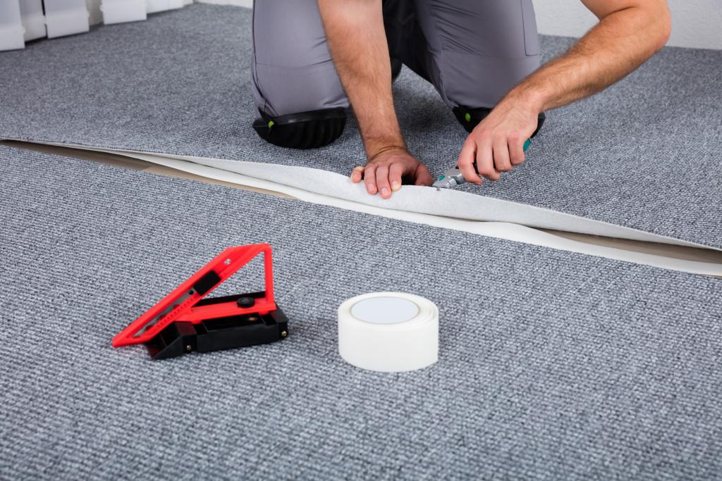 man installing carpets