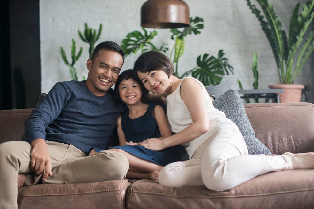 family smiling in couch