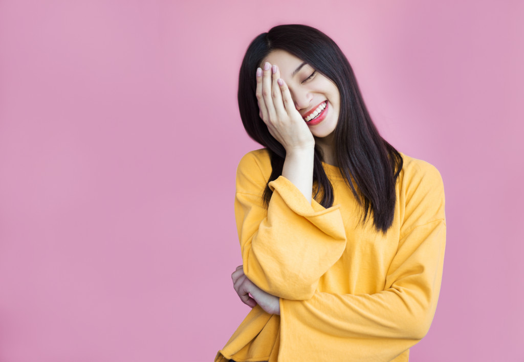 smiling woman in yellow