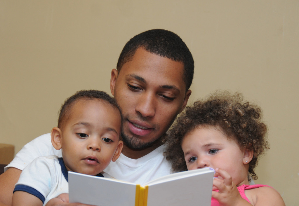 reading a book to children
