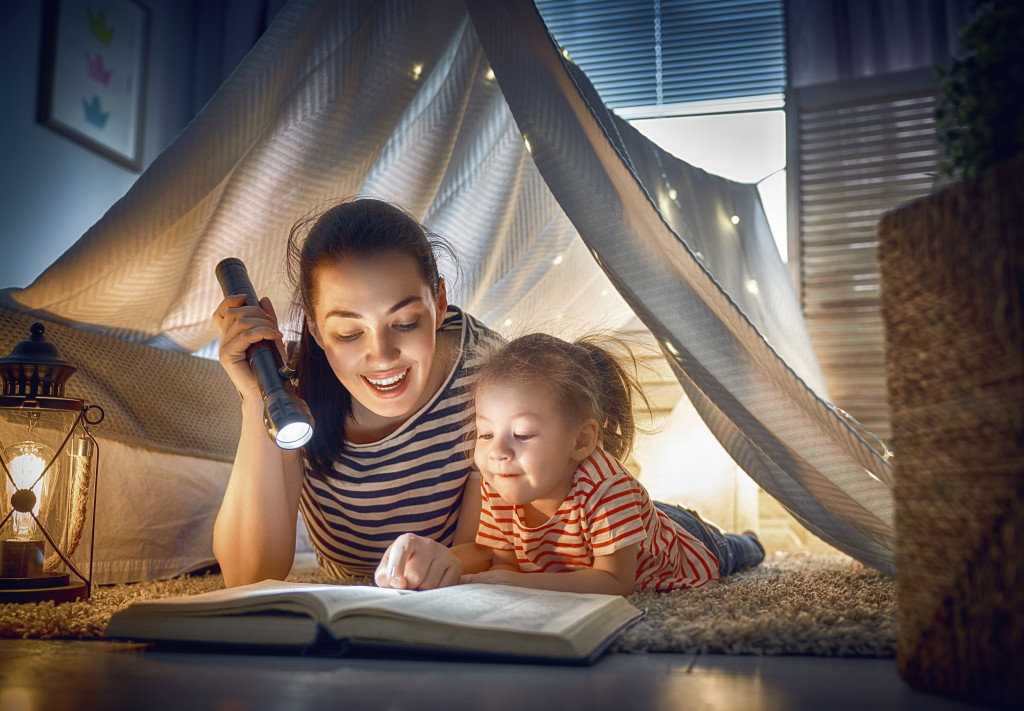 parent reading a book to child