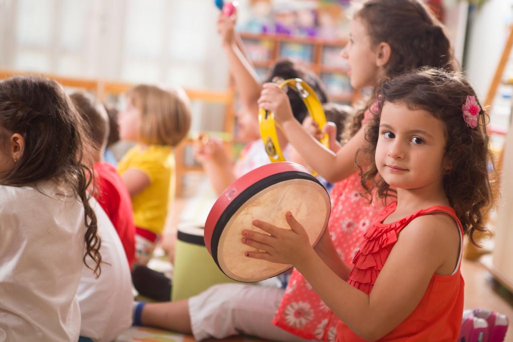 child playing the tambourine