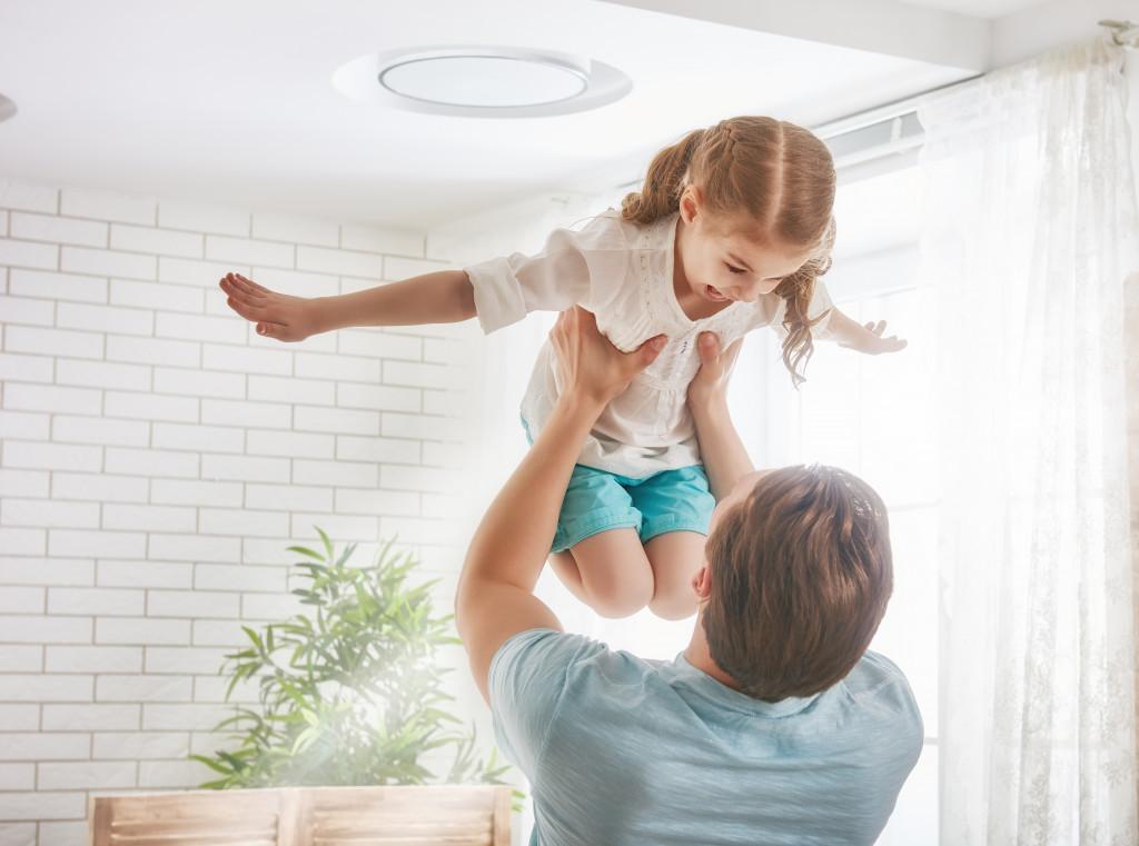man raising daughter